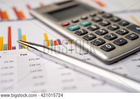 Calculator On Graph Paper. Finance Development, Banking Account, Statistics, Investment Analytic Res
