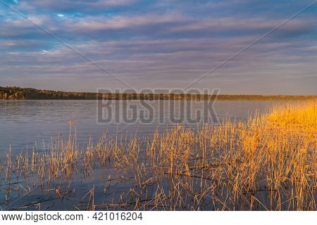 Russia. May 14, 2021. Evening Sunset On A Warm May Evening On Sukhodolsky Lake In The Leningrad Regi