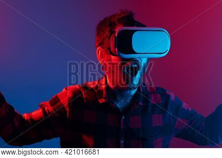 Young Man Hallucinating And Enjoying An Immersive Experience With Virtual Reality Technology. Portra