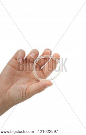 Birth Control ,hormone, Contraception Ring In A Womans Hand Isolated On White Background, Vaginal Ri