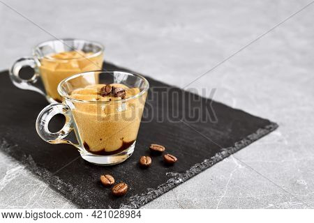 Traditional Italian Dessert Coffee Cream In A Glass Cup On Gray Stone Background. National Cuisine R