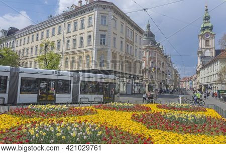 Graz, Austria-april 25, 2021: Spring Flowers On Famous And Crowded Herrengasse Street With Shops And
