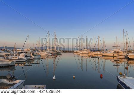 Port Of Charming Aegina Town With Yachts And Sail Boats Docked In Aegina Island, Saronic Gulf, Greec