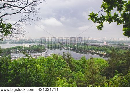 Kyiv, Ukraine - May 18, 2021: Landscape View Of The Left Side Of Kyiv On Dnipro River With Bright Gr