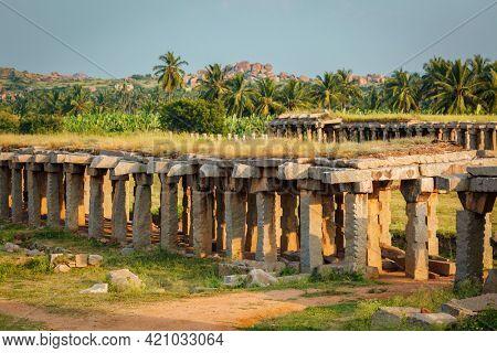 Ancient ruins of Hampi on sunset. Hampi, Karnataka, India