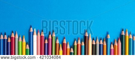 Colouring Pencils Isolated On Blue Background Close Up Concept With Copy Space For Text