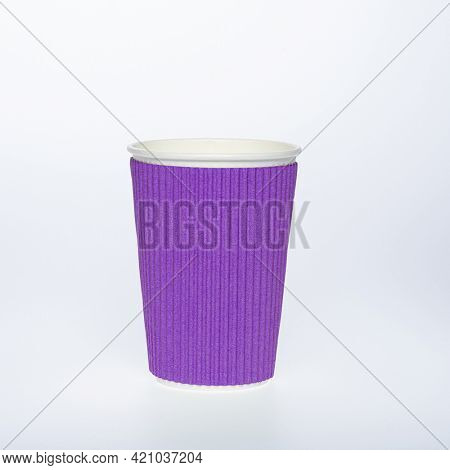 Photo of a disposable green paper cup on a white background. Photo of a colored coffee cup made of recyclable materials. Empty paper coffee cup.
