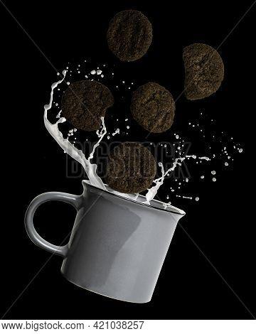 Milk And Cookies Dunking In Coffee Mug