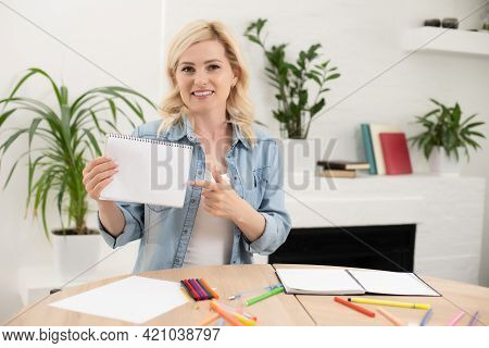 Portrait Of A Serious Female Schoolteacher In The Classroom