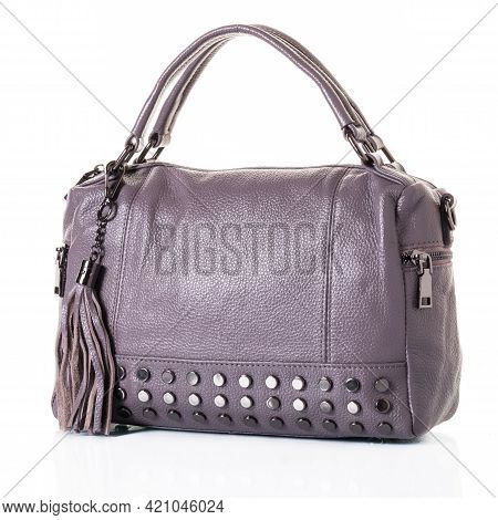 Grey Bag For Women With A Shorts Handles. The Model Is Made Of Genuine Leather, Decorated With Metal