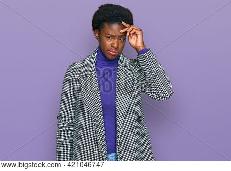 Young african american girl wearing casual clothes worried and stressed about a problem with hand on forehead, nervous and anxious for crisis