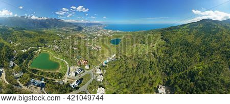 Aerial view of Yalta town and Two magabi lakes. Spring mountain forest, and sea shore.