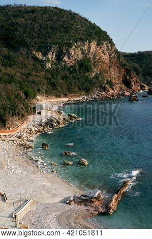 Crvena Glavica Beach Against The Backdrop Of The Sea And Mountains, In The Budva Riviera, Montenegro