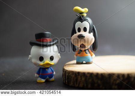 Samut Prakan, Thailand - May 20, 2021 : Cute Figurine Goofy And Scrooge Mcduck, Collection Figurine