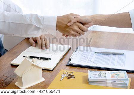 Sale Representative Or Insurance Broker Handshake With Customer