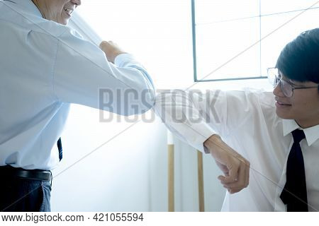 Businessman Say Hi To Another No Handshake But Use Elbow Bump