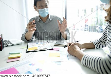 Business Man Woman Consulting In Meeting Wearing Mask