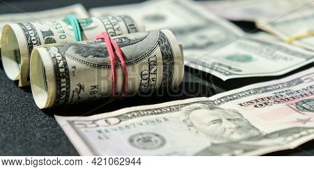 Us Dollars Bundle Close Up Isolated On Dollar Background. Paper Denominations Of Dollars Cash Rolls