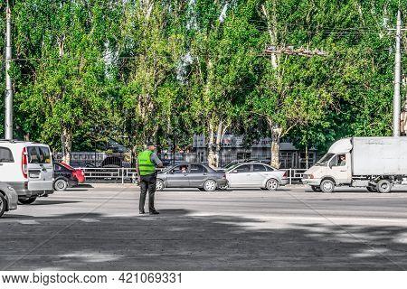 Kherson, Ukraine - July 22, 2020: A Traffic Cop Regulates Traffic On The Street In Kherson - View Fr