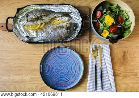Feast.laid Table With Food.beautiful Table Setting Of Mediterranean Food.grilled Fish With Salad.coo