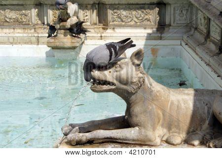 Pigeon Kissing Dog Statue