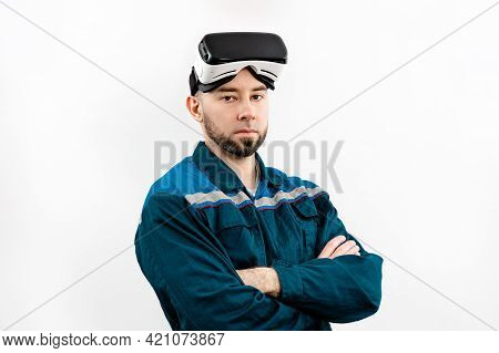 Portrait Of An Adult Man In Virtual Reality Glasses, Work Uniform, Arms Crossed. Isolated On A White
