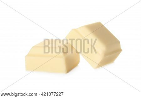 Pieces Of Tasty Sweet Chocolate Isolated On White