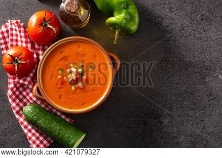 Gazpacho Soup In Crock Pot And Ingredients On Black Stone. Top View. Copy Space