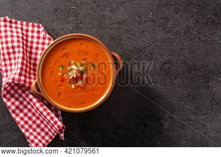 Gazpacho Soup In Crock Pot On Black Stone. Top View. Copy Space