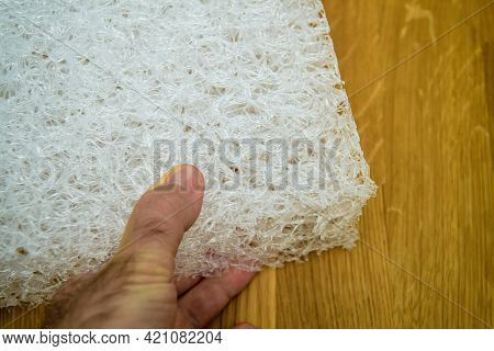 Pov Male Hand Holding New Polyethylene Plastic Mattress Made From Recycled Plastic