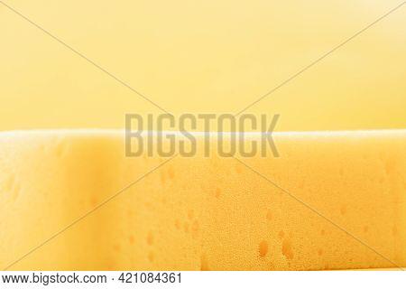 Yellow Sponge On Yellow Background.yellow Sponge On Yellow Background