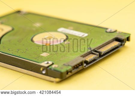 Hard Disk On Yellow Background.hard Disk On Yellow Background
