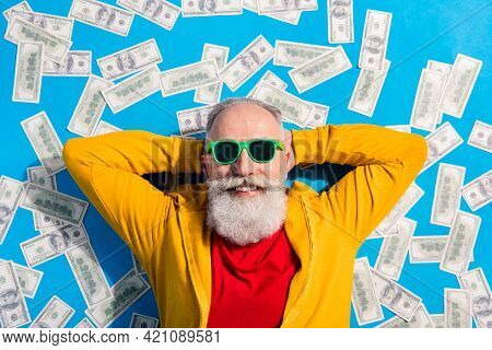 High Angle View Photo Of Positive Smiling Grandfather Lying Floor With Money Millionaire Isolated On