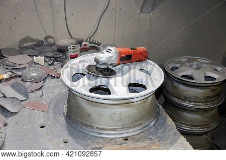 Restoration Of Light-alloy Car Wheels In Garage.