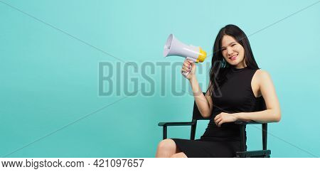 Black Director Chair And Asian Woman Is Hold Megaphone And Sitting On It.it Put Green Mint Color Or