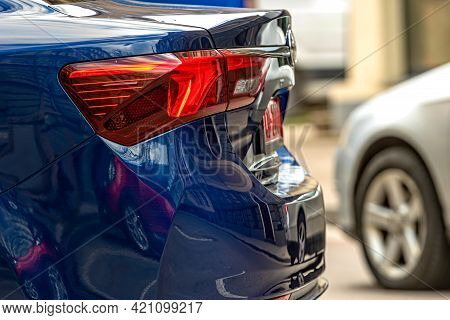 Rear Half With Rear Lights Of A Parked Car On The Side Of The Street, Vehicle Exterior Details, Clos