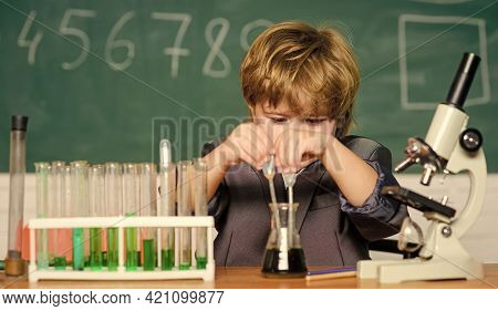 Science Experiments With Microscope At Lab. Kid Scientist Studying Science. Biology Science. Little