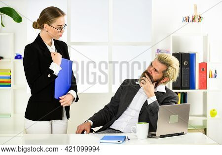 Male Boss With His Secretary. Office Couple Discuss Business. Modern Office Life. Accountant Or Secr