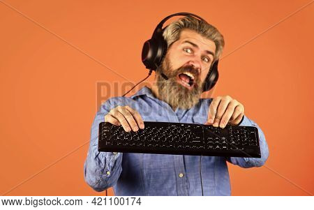 Superior Performance. Graphics Settings Pushed To Limit. Play Computer Games. Man Bearded Hipster Ga