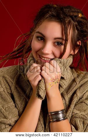 Beautiful Young Woman With Dreadlocks On A Red