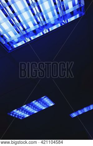 Abstract Background With Blue Fluorescent Lights. Neon Glow From The Ceiling Lights. Close-up.