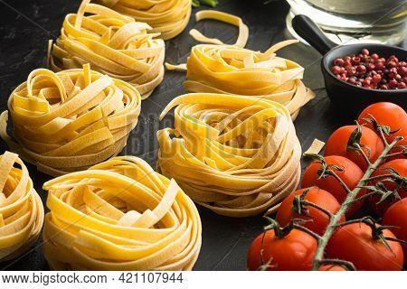 Pasta Tagliatelle With Ingredients Set, On Black Stone Background