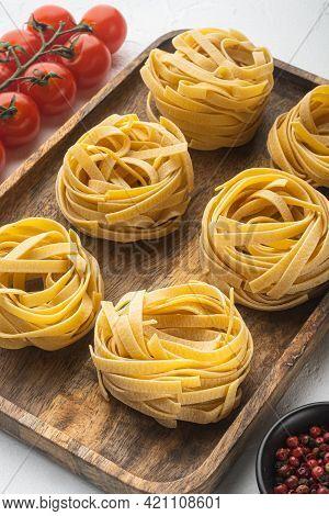 Pasta Tagliatelle With Ingredients Set, On White Stone  Background