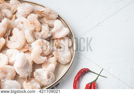Pink Frozen Shrimps With Ice. Uncooked Peeled Seafood Set, On Plate, On White Background, With Copy