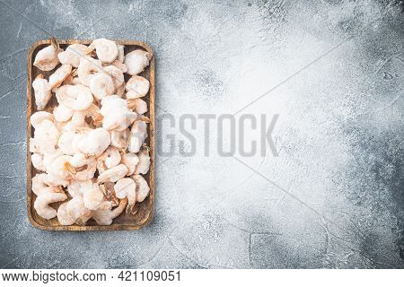 Pink Frozen Shrimps With Ice. Uncooked Peeled Seafood Set, On Wooden Tray, On Gray Background, Top V
