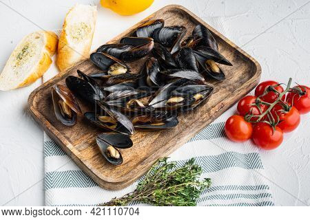 Boiled Mussels In Garlic Sauce With Parsley And Ingredient, On Wooden Tray, On White Background