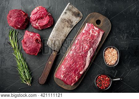 Gourmet Portion Of Raw Fresh Marbled Beef Fillet Set , With Old Butcher Cleaver Knife, On Black Ston