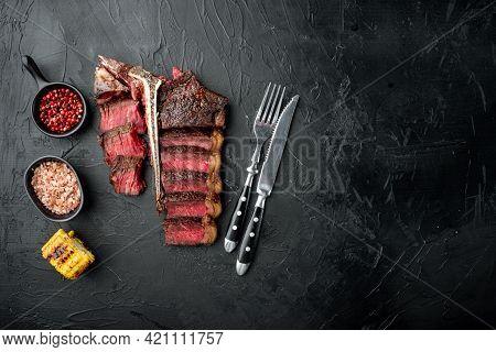 Fresh Juicy Medium Rare Sliced And Roast T Bone Or Porterhouse Beef Meat Steak Set, On Black Stone B