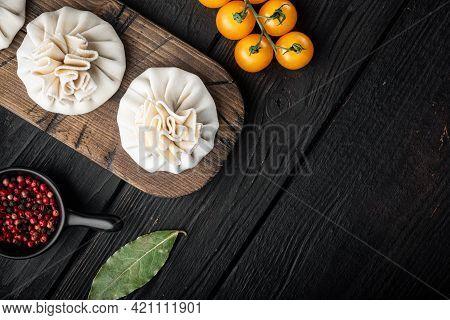 Uzbek Manti. Manti Or Manty Dumplings, Popular Uzbek-asian Dish Set, On Black Wooden Table Backgroun