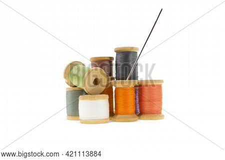 Wooden Bobbins For Gray, Orange, Burgundy, Purple Threads On White Isolated Background. Handmade, Ne